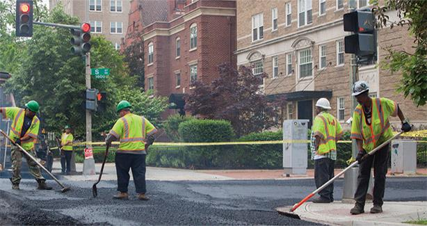 Workers repairing a street